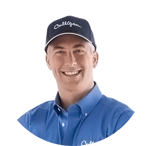 Smiling Culligan man in cap